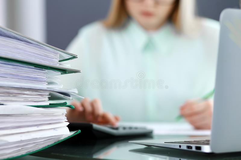Bookkeeper or financial inspector making report, calculating or checking balance. Audit and tax service concept. Green. Bookkeeper or financial inspector  making royalty free stock photos