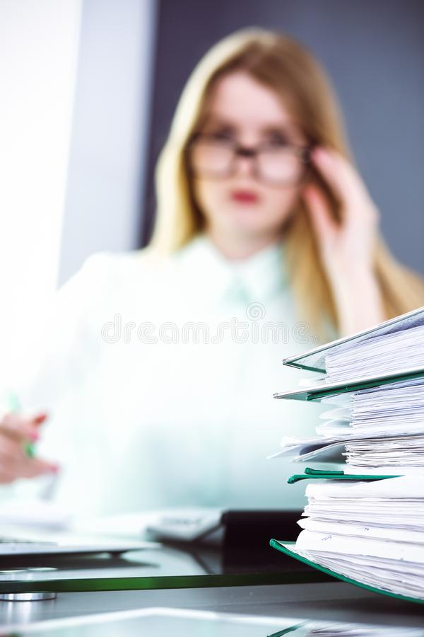 Bookkeeper or financial inspector making report, calculating or checking balance. Audit and tax service concept. Green royalty free stock images