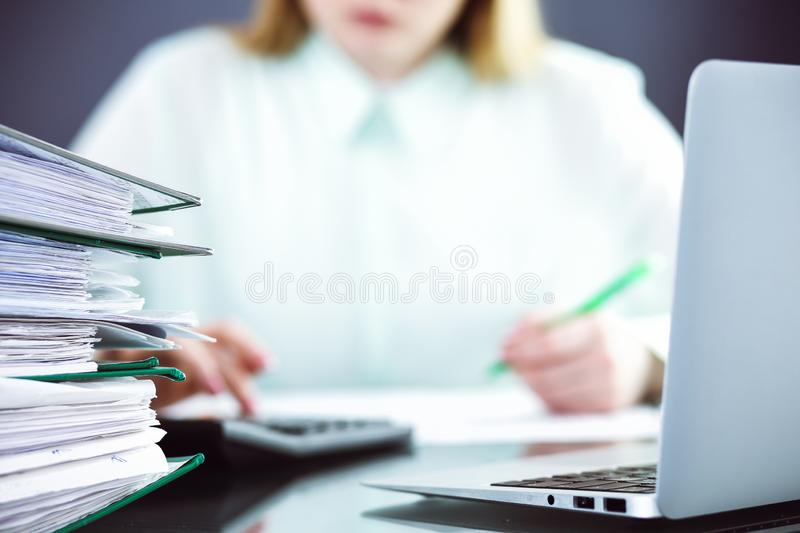 Bookkeeper or financial inspector making report, calculating or checking balance. Audit and tax service concept. Green stock photography
