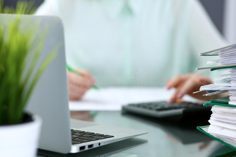 Bookkeeper or financial inspector making report, calculating or checking balance. Binders with papers closeup. Audit an royalty free stock images
