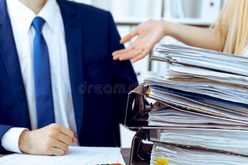 Bookkeeper or financial inspector and secretary making report, calculating or checking balance. Internal Revenue Service. Inspector checking financial document stock photos