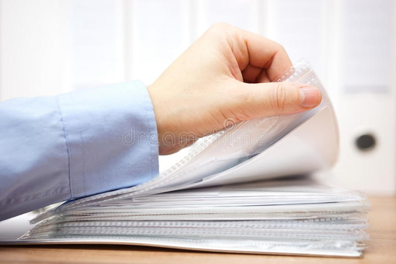 Bookkeeper is reviewing invoices and documentation. Isolated stock image