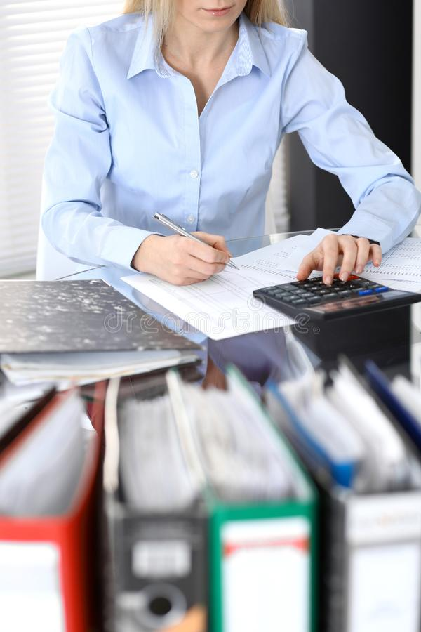 Bookkeeper woman or financial inspector making report, calculating or checking balance, close-up. Business portrai. T. Copy space area for audit or tax concepts stock photography