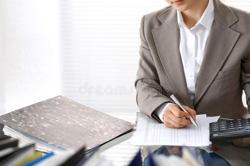 Bookkeeper woman or financial inspector making report, calculating or checking balance, close-up. Business portrai. T. Copy space area for audit or tax concepts royalty free stock photography