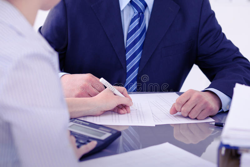 Bookkeepers or financial inspector making report, calculating or checking balance. Audit concept. Bookkeepers or financial inspector making report, calculating royalty free stock image