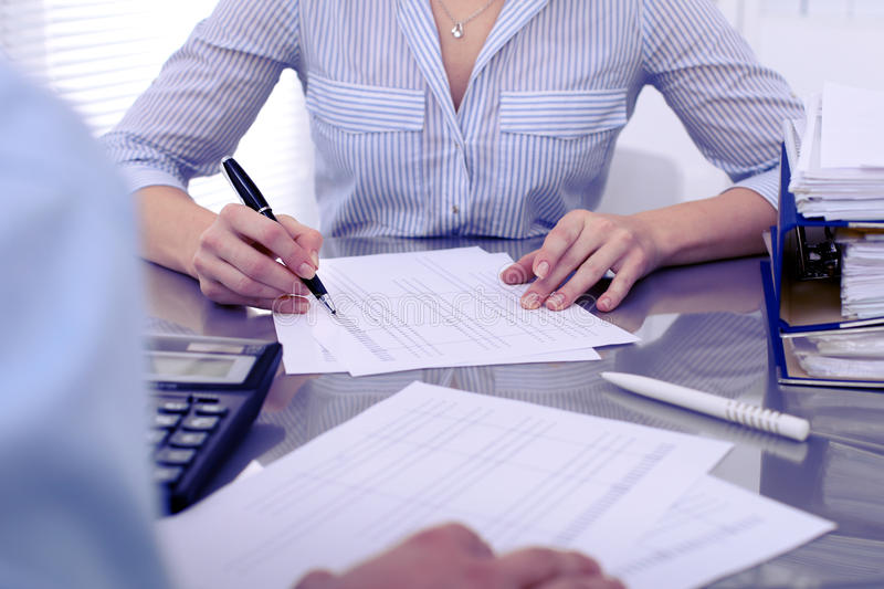 Bookkeepers or financial inspector making report, calculating or checking balance. Audit concept. Bookkeepers or financial inspector making report, calculating royalty free stock photo