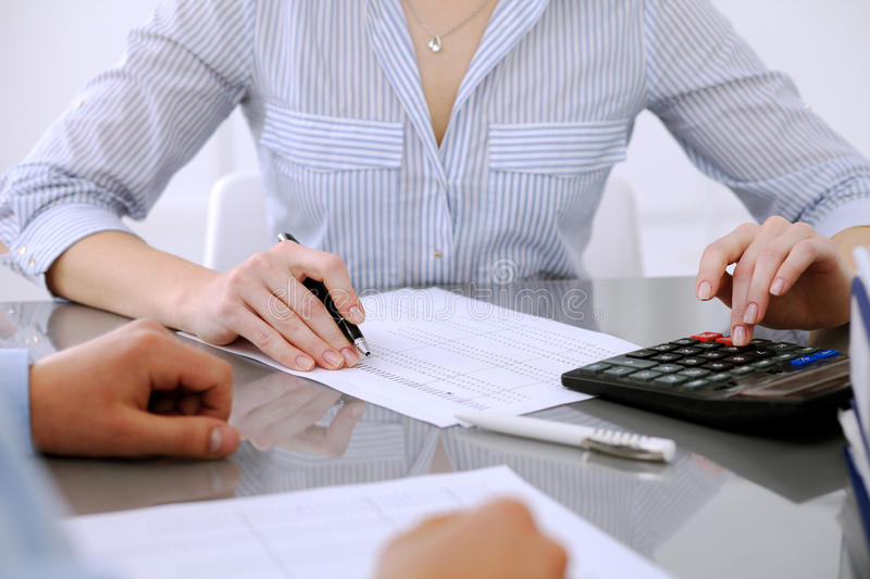 Bookkeepers or financial inspector making report, calculating or checking balance. Audit concept. Bookkeepers or financial inspector making report, calculating royalty free stock photos