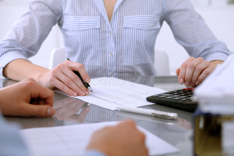 Bookkeepers or financial inspector making report, calculating or checking balance. Audit concept. Bookkeepers or financial inspector making report, calculating royalty free stock photography