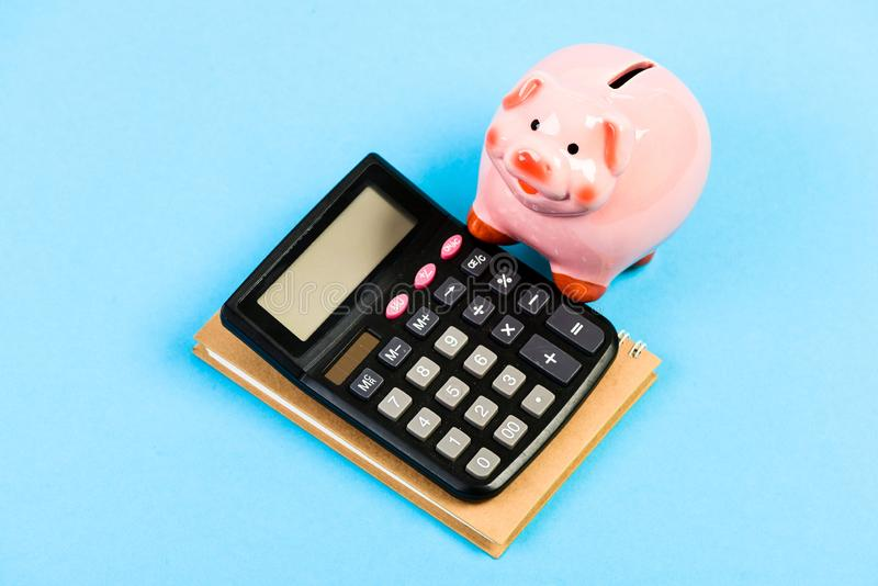Bookkeeping. financial report. planning counting budget. Commerece business. moneybox with calculator. Piggy bank. money royalty free stock images