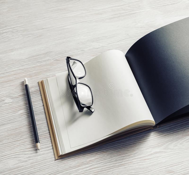 Booklet, glasses, pencil stock photography