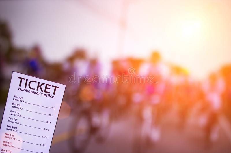 Bookmaker ticket on the background of the TV showing cycling, sports betting, cycling. Bookmaker ticket on the background of the TV showing cycling, sports stock photography