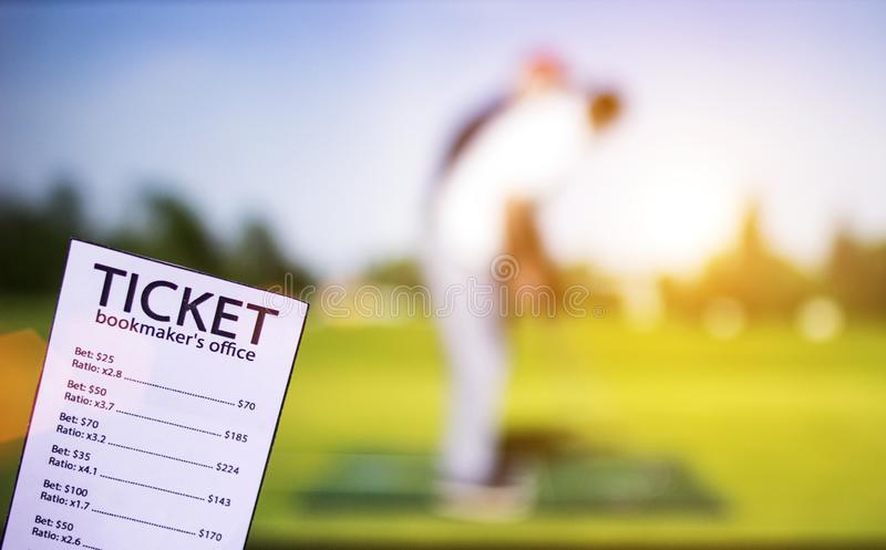 Bookmaker ticket on the background of the TV showing golf, sports betting, game golf. Bookmaker ticket on the background of the TV showing golf, sports betting royalty free stock photos