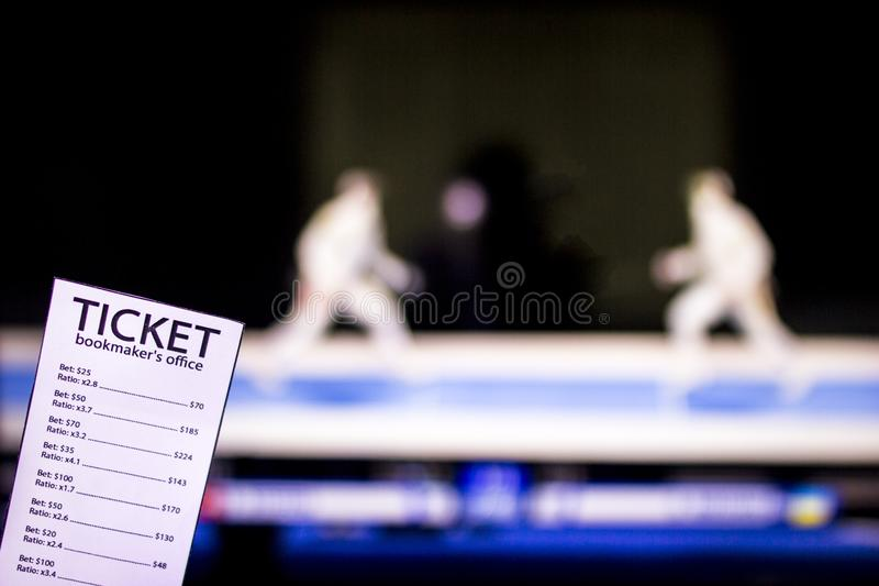 Bookmaker ticket on the background of the TV on which show sport fencing, sports betting, Bookmaker, swordplay. Bookmaker ticket on the background of the TV on stock image