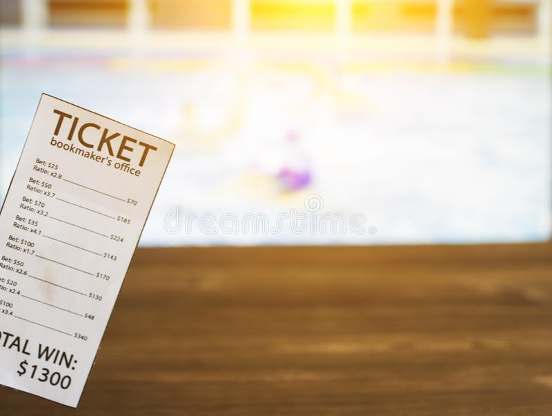 Bookmaker ticket on the background of the TV on which show water polo, sports betting, water polo. Bookmaker ticket on the background of the TV on which show stock image