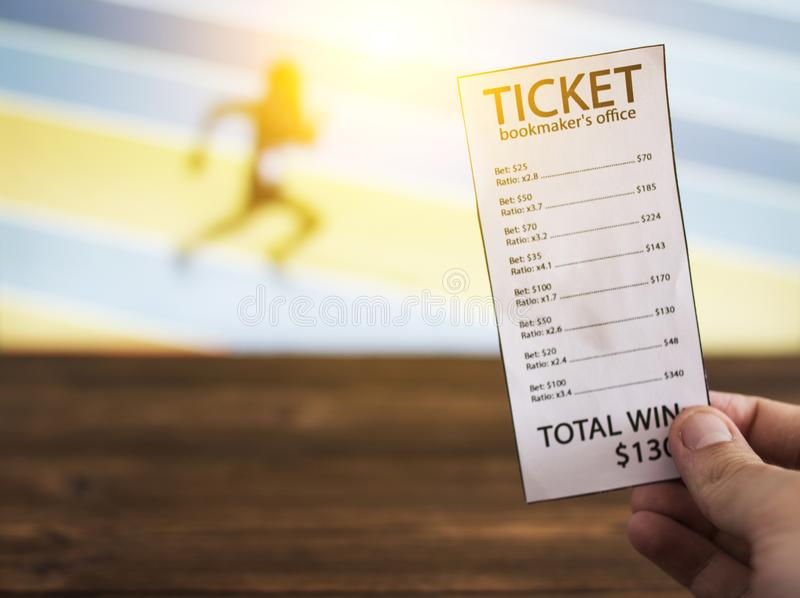 Bookmaker ticket on the background of the TV, which shows athletics, running, jumping, sports betting, Bookmaker ticket. Bookmaker ticket on the background of stock image