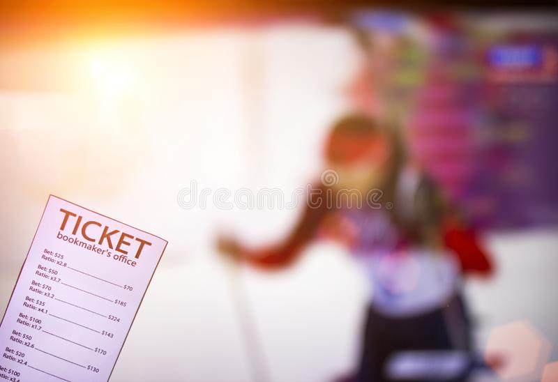 Bookmaker ticket on the background of the TV, which shows biathlon, sports betting, bookmaker and biathlon. Bookmaker ticket on the background of the TV, which royalty free stock photos
