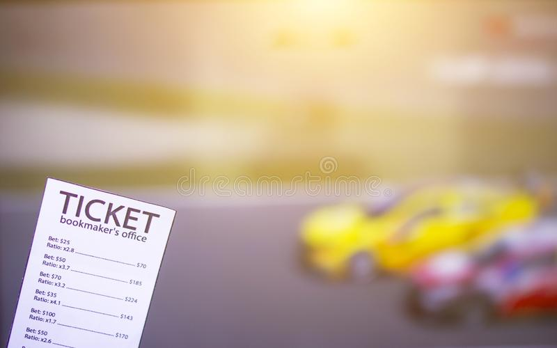 Bookmaker ticket on the background of the TV, which shows the car rally, sports betting, auto racing. Bookmaker ticket on the background of the TV, which shows royalty free stock images