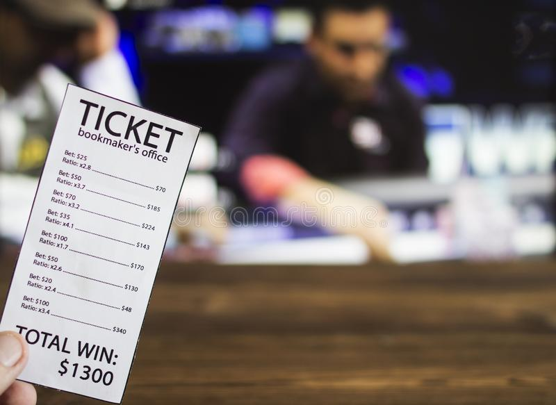 Bookmaker ticket on the background of the TV, which shows a game of cards, poker, sports betting, bookmaker. Bookmaker ticket on the background of the TV, which stock image