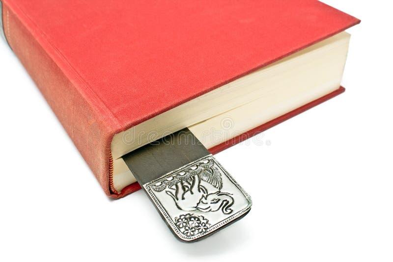 Bookmark in einem Buch lizenzfreie stockbilder