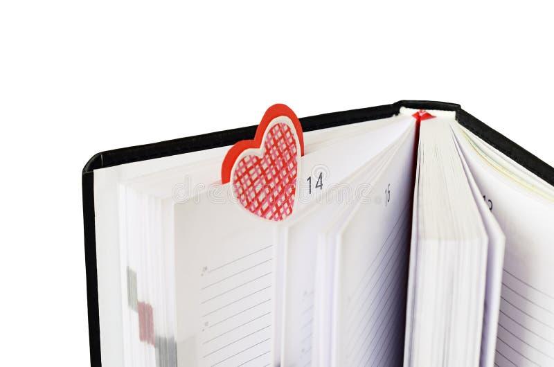 Bookmark in un taccuino per il giorno del ` s del biglietto di S. Valentino fotografie stock