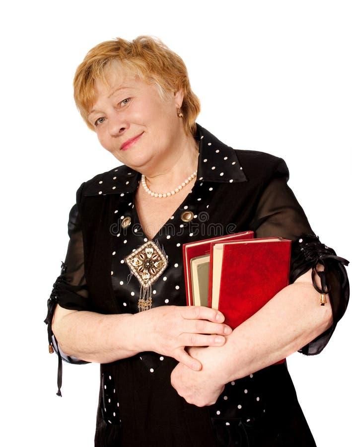 books åldringhandkvinnan arkivfoton