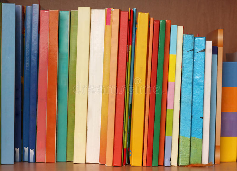 Books. Row of books in different colours and sizes neatly placed. No logos or titles visible stock image