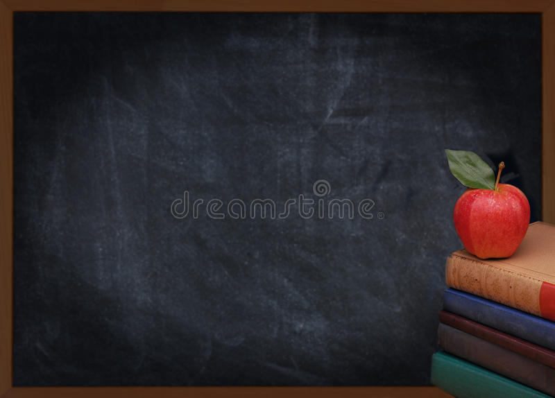Books Apple and Chalkboard royalty free stock photography