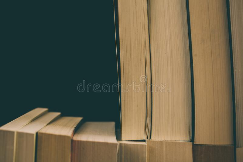 Books background. Old vintage books background. Education and knowledge, learn, study and wisdom concept. Stack of old books. Old books on a shelf, stacked old royalty free stock images