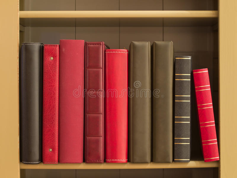 Books in a bookshelf stock images