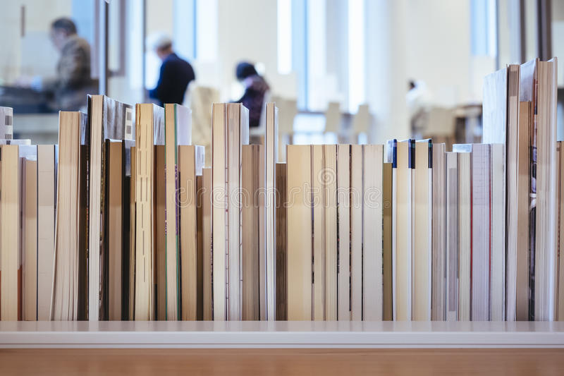 Books on bookshelf blur People reading in Library. Education royalty free stock images