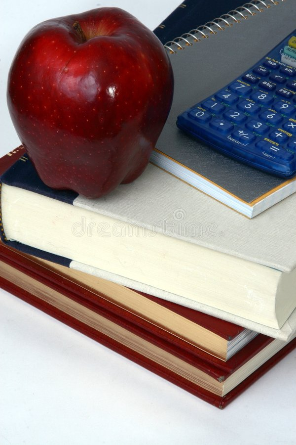 Books, calculator and apple stock photography