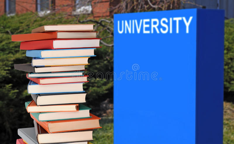Books on campus of university. Concept of higher education: books on campus of university stock photography