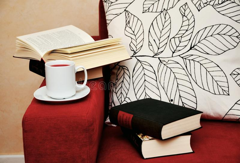 Books and coffee on armchair