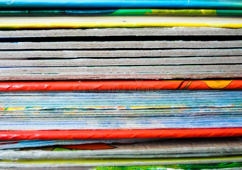 Books with colorful covers lined up on a bookshelf. Bright abstract background. back to school. Colorful book binding stock photo