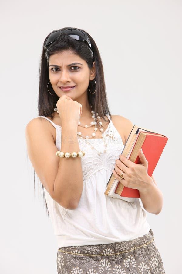 books den glamorösa flickan royaltyfri foto