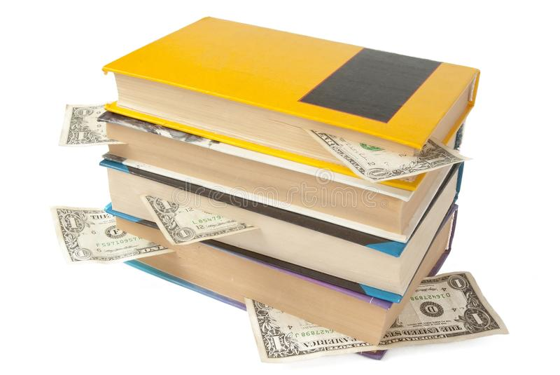 Books with dollar bookmarks. Over white stock images