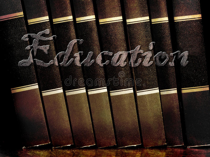 Books of Education. Row of old leather books on a shelf with word education cover royalty free stock photography