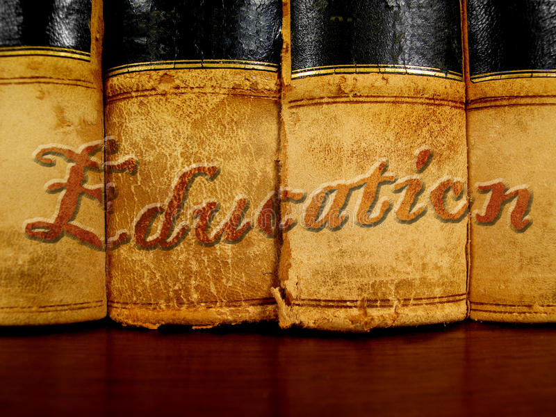 Books of Education. Row of old leather books on a shelf with word education cover royalty free stock photos