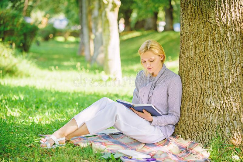 Books every girl should read. Relax leisure an hobby concept. Best self help books for women. Girl concentrated sit park royalty free stock image