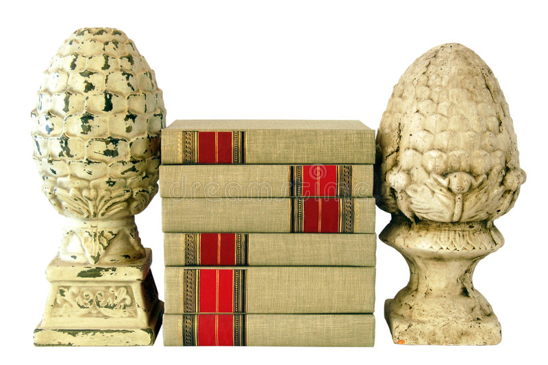 Books with Finials. Stack of cloth bound books with finials as bookends royalty free stock photography