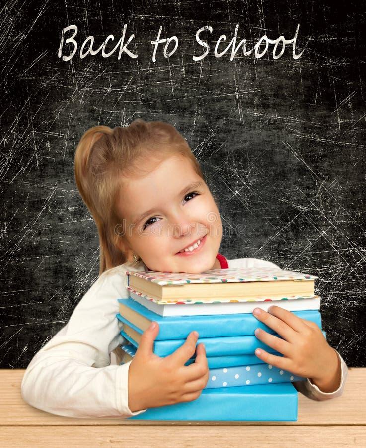 books flickan schoolgirl i klassrum tillbaka skola till arkivfoton