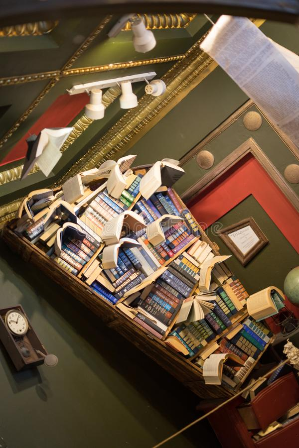 Books flying from book shelf in the Last Bookstore. The Last Bookstore, Los Angeles, California, USA: 06/29/2018 - The Last Bookstore stock image