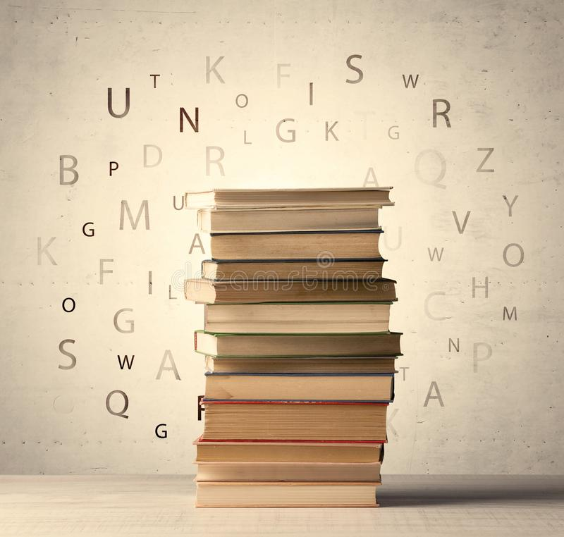 Books with flying letters on vintage background stock photo