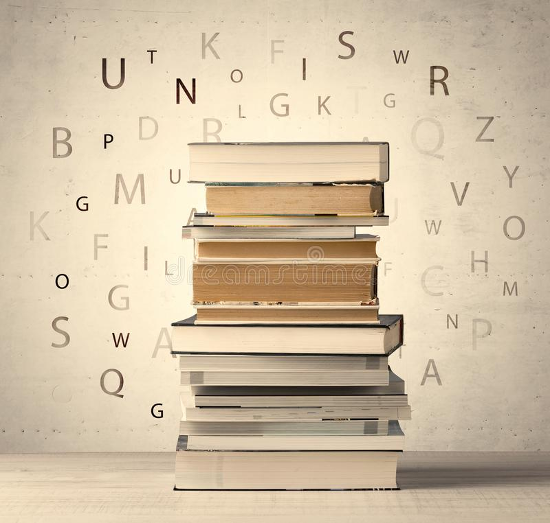 Books with flying letters on vintage background royalty free stock images
