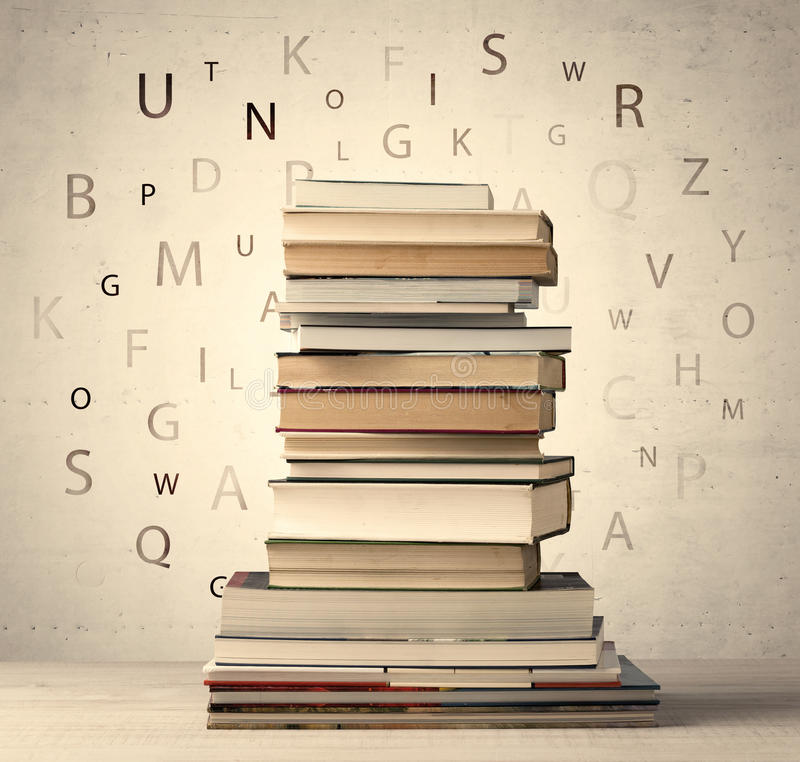 Books with flying letters on vintage background. Books with flying letters on vintage old background stock photo