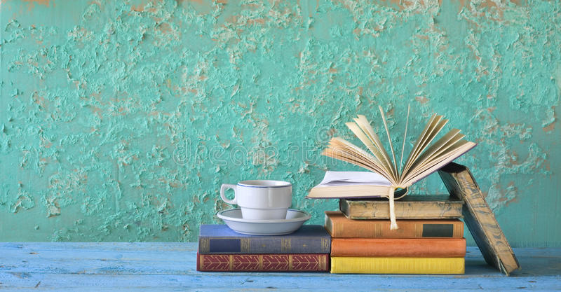 Books, free copy space. Old books and cup of coffee, free copy space stock photos