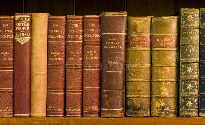 books gammala arkivlott royaltyfri bild