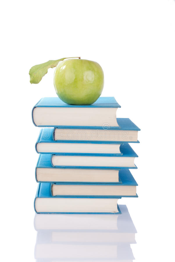 Books and green apple royalty free stock photography