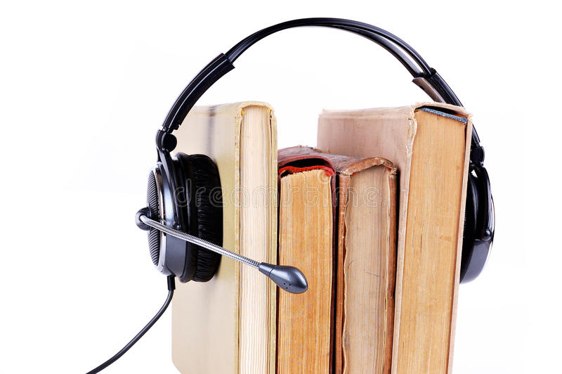 Books in headsets. On a white background royalty free stock photos