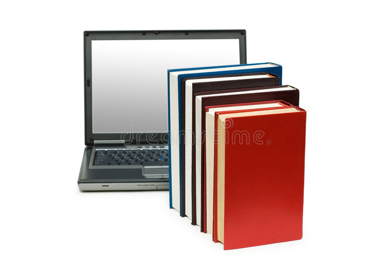 Books and laptop isolated on the white royalty free stock photo